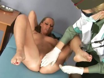 Military doctor examines blonde's pussy