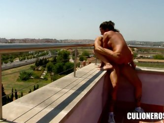 Noemi Jolie gets her pussy fucked from behind on a balcony