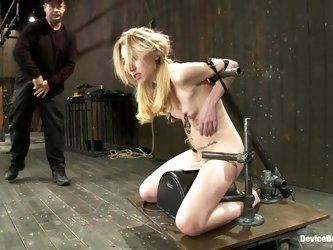 Bondaged blond sucks a cock and eats a twat of her masters