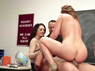 A dude is fucking to eager women in front of a crowd in the classroom. Sexy ladies are fully exposed and they love having someone watching them as the