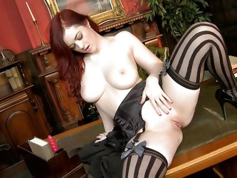 This a classic redhead lady that loves to fuck her sweet pussy in front of the camera. Look at her long sexy red hair, hot big natural tits, sexy boot