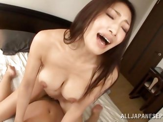 This dirty slut sucks on her man's cock to get him nice and hard and then she goes wild. The sexy brunette lady jumps on his cock and rides him f