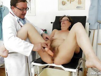 Saggy whore Slaven is at her gynecologist. The doc putted her to take a sit on the special table and then she spread her legs. He putted some lube on