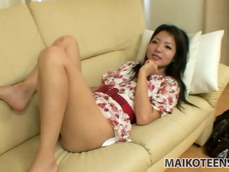 Cute teen girl Nao Miyazaki lies on the couch and pulls off her pink panties. Her fresh tight pussy attracts mature man and he would like to help her!