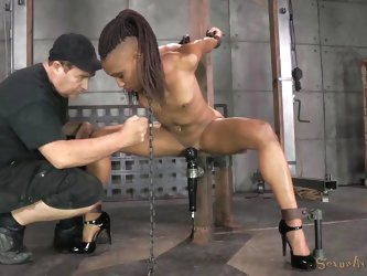 This ebony slave is tied up and face fucked by her master. He shoves his black cock deep into her throat. Her hand are tied behind her back and she ha
