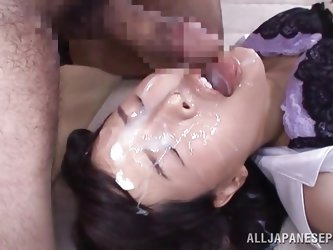 The slutty Asian babe in the video has a horny cock in her lusty pussy and another dick in her mouth. She has got small lovely natural tits and a hair