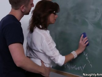 Sexy biology teacher Veronica wearing a black stockings seduces her horny student by her gorgeous forms. Dude sniffs her cunt and bangs her doggystyle