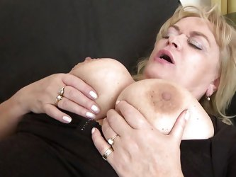 Busty whore Helena grabs her man's cock with passion and gives it a short, mean lick before putting it between her big breasts. She rubs his cock