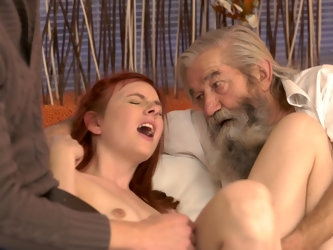 Two gentlemen, one old and one young, double teamed this ginger lady. After getting her naked, they started rubbing and stuffing her pussy with their