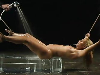 Her hot body melts the ice and she screams after the executor removes the ball gag from her mouth and gives this dirty slut a nice cold shower. She
