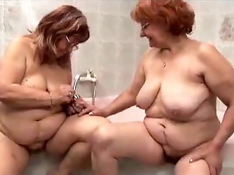 Two chubby grannies loved to touch and caress each other in the Jacuzzi and play with as they felt way too horny while getting naked.