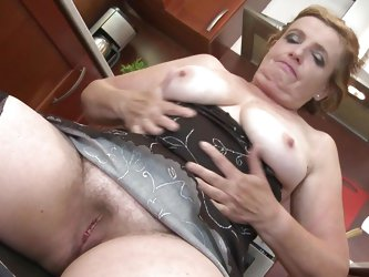 Martina K. takes a break from cooking to spread her legs wide so you can see her old, hairy cunt. She masturbates real fast and you get a nice close u