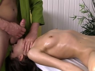 Oiled up vixen gets her body taken care of on the massage table