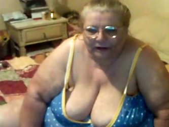 Look at this horny blonde grandma. She is a slutty obese whore and wants a guy to fuck her from behind and that's why she shows her butt on webca
