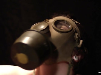 Brunette teen masturbates in a gas mask and deep throats a cock