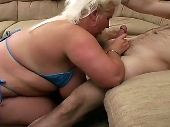 King sized BBW blonde slut weighs 300 lbs and loves being so fat. Check out how she kneels down and gives nice blowjob and takes load of sperm on her